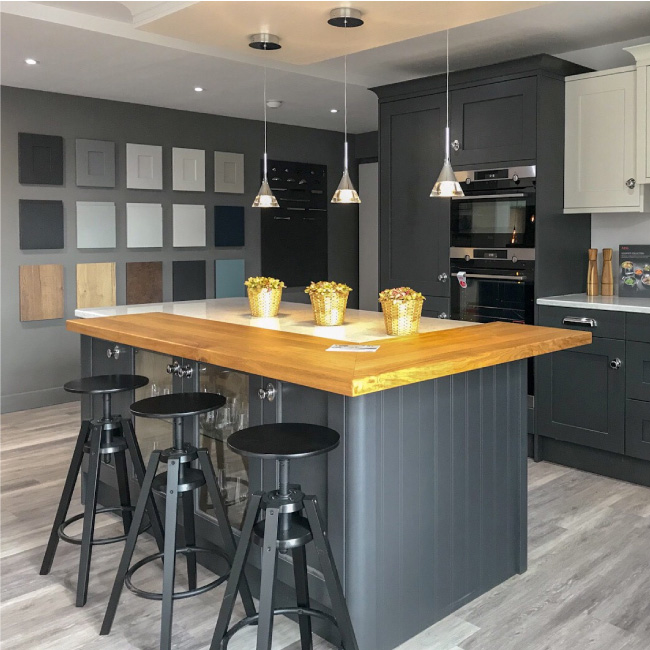 Kitchen showroom design and styling grey and cream cupboards, samples board